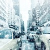 Taxis and SUV's weather the winter storm through New York.