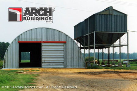 A metal arch building with sliding shop doors for easy access.